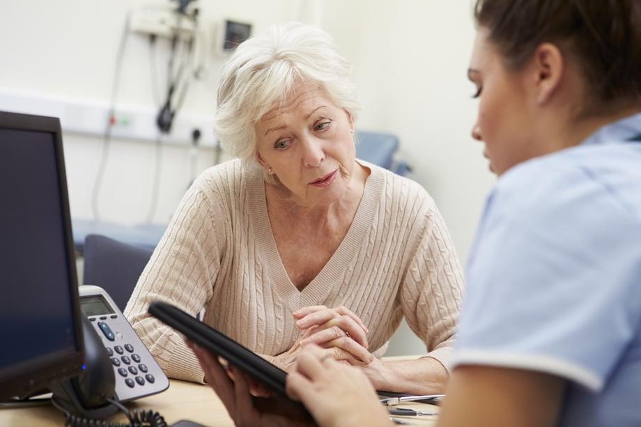 doctor-showing-patient-simple-EHR-using-InteliChart