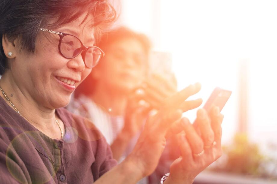 woman-using-intelichart-patient-engagement-platform-on-mobile-device